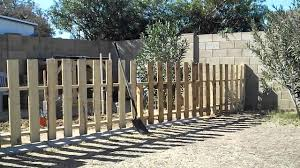 how to build a garden fence using reclaimed pallets