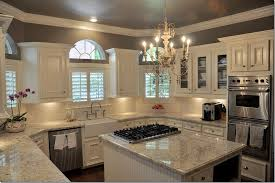 dark wood floor white gray granite white cabinets cream backsplash we know how to do it