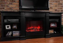tv stand withplace heather bates design rustic style family room decor electric black finished audio cabinet red brick wall unfinished wooden