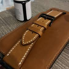 handmade handstitched watch strap in hermès golden barenia leather for clients hermès iwatch luxury watches on carou
