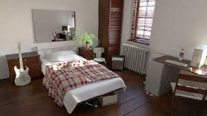 Elegant Tidy Bedroom With White Bed Red Bige Quilt Wooden Floor Desk And Guitar  Image