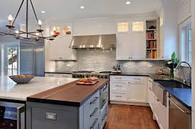 white cabinets with butcher block countertops counter