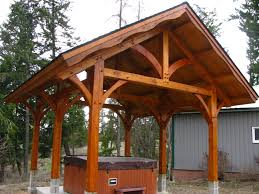 a former client came asked us to build a timber frame pavilion over their hot tub to keep the rain and snow off they wanted it to coordinate with the home