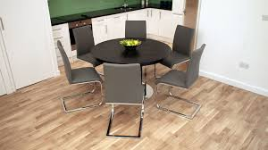 swing dining chairs and dark wooden extending dining table