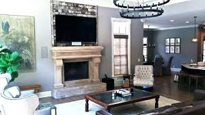 tv mounted on fireplace on wall above fireplace mount installation tv mounting over fireplace ideas