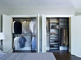 chocolate pear double closet with clothes hanging and shelf tower
