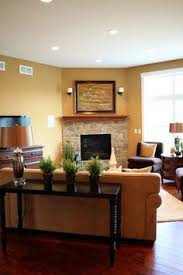 traditional living room by design decorate around corner fireplace
