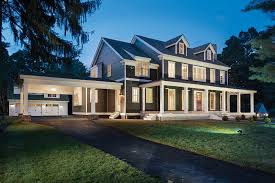 five bedroom house. details: this five-bedroom home boasts traditional architectural features, including a wraparound front porch and porte-cochere entrance. five bedroom house