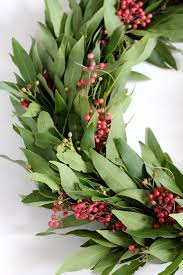 learn how to make this bay leaf and berry wreath