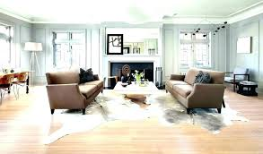 area rug over carpet rugs finest cowhide living room with cleaner al cleaning o