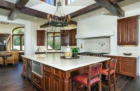 Beautiful Tuscan style kitchen with white marble counter and dark wood  floors