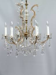 6 arm chandelier with flowers and kite drops
