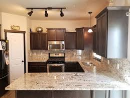 brown and cream traditional kitchen with granite countertops