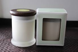 pure soy wax candle infused with pure essential oils in frosted glass jar