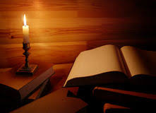 still life with old book and burning candle royalty free stock photos