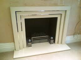 limestone stepped fireplace living room fireplace completed limestone art deco styled with metal trim