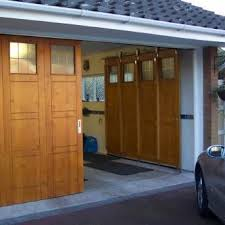 alternative or unusual garage door opening ideas the garage journal board are these called sliding