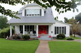white house black shutters with red door