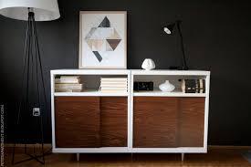 mid century modern cabinet in dark wall living room from ikea besta shelf unit with