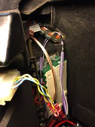 gas pcn install location and pics in a touring as it stands now my sub works it wired the violet wires from the pcn going to it not really a surprise there however my rear mids the ones in