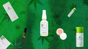 beauty s that contain cbd oil against a green background