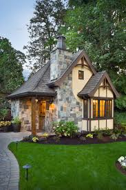 cottage design ideas exterior traditional with tudor style outdoor lighting stone fireplace