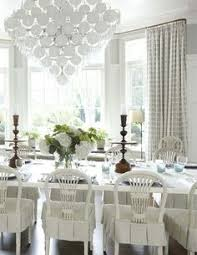 love the slipcovered chairs find this pin and more on painted dining