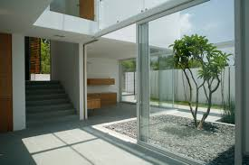 exterior extraordinary luxury modern home interiors. Architecture Mesmerizing Small Courtyard Modern Minimalist Block House Design With Glass Sliding Door And White Interior Exterior Extraordinary Luxury Home Interiors