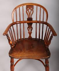early 19th century yew wood windsor arm chair with elm seat the back with