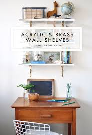 acrylic and brass wall shelves the painted hive