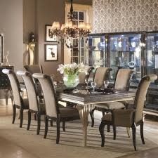 flower arrangements dining room table: antique bronze chandelier over flower dining table centerpieces with curved back arms dining chairs also open display cabinet