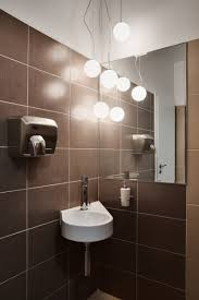 Simple Luxury Idea For Inspiring Design With Brown Tile Wall Also - Hand dryers for bathrooms