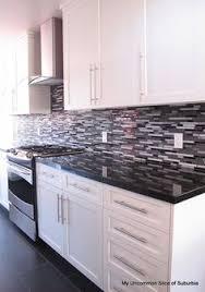 white cabinet kitchen. black and white cabinet kitchen