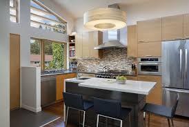 single large rounded kitchen island lighting low ceiling modern kitchen design solid brown wooden kitchen cabinets storage stainless kitchen hardware white