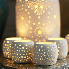 ceramic candle holders... I adore This would look really cool if they were