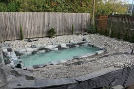 ordinary looking pool overflows to become a stunning all natural pond throughout diy backyard pools plan