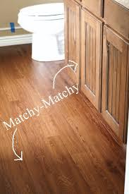 Master Bathroom Peel and Stick wood plank flooring $45