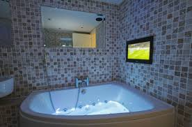 millbrook cottages lakeview luxury bathroom with tv and whirlpool bath