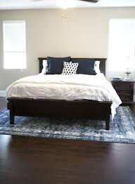 rug under king bed rug under queen bed king size bed rug placement