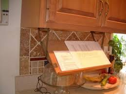 cookbook storage retractable bookstand mounted underneath a kitchen cabinet