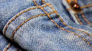 Extreme Close Up Tilt Shot Of The Dark Blue Denim Fabric Of Jeans