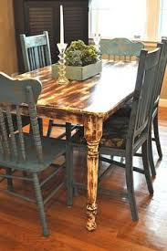 distressed table with blue chairs