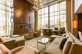 find this pin and more on cambria by choice hotels lobby with fireplace lobby with fireplace cambria suites plano texas