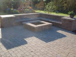 square fire pit Patio with Fireplace lighting Pool seating