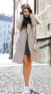 fashion blogger veronika lipar of brunette from wall street wearing black and white plaid tweed mini