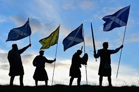 scotland s healthcare system becomes key referendum issue time men from king of scots robert the bruce society hold the scottish flags as they
