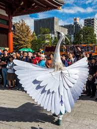 Asakusa Shirasagi no Mai 8/10 Another pose from the White Heron Dance with  the dancers turning around and showing their wings in full spl…