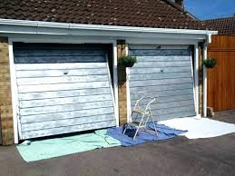 how to paint a garage door with brush best for doors painting metal roller spray brus painting doors with a roller