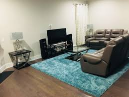decor with grey sofa and blue rug