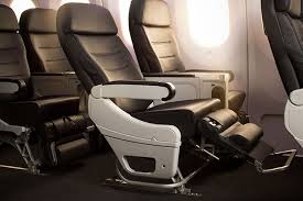 air new zealand premium economy seat with leg support and foot rest extended